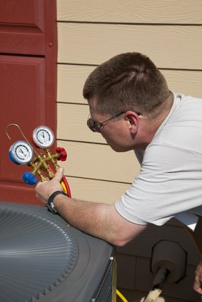 HVAC Tech Working on Air Conditioner